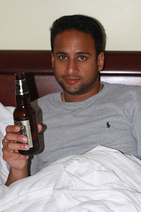 Saumil drinking in bed
