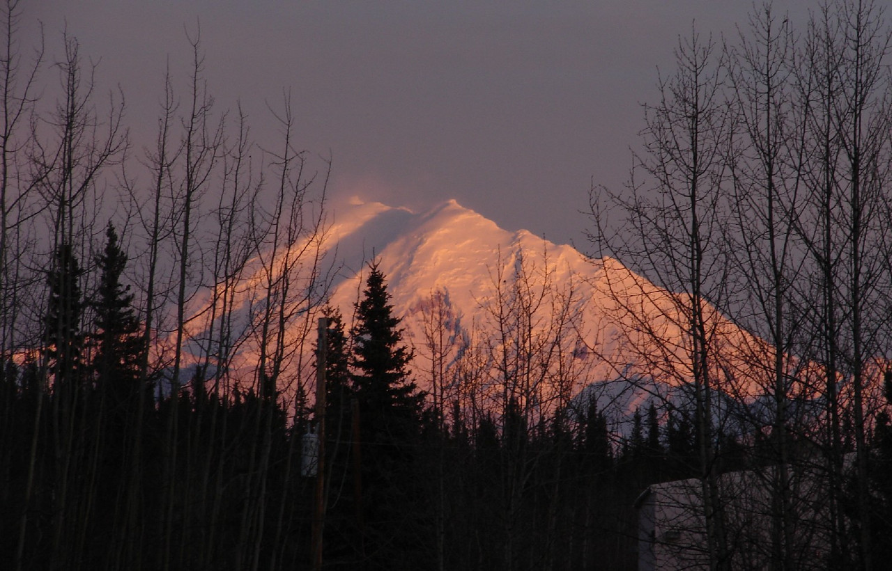 The setting sun casts an orange glow over Mt. Drum, just east of Glennallen.  This shot taken from right outside the front door.