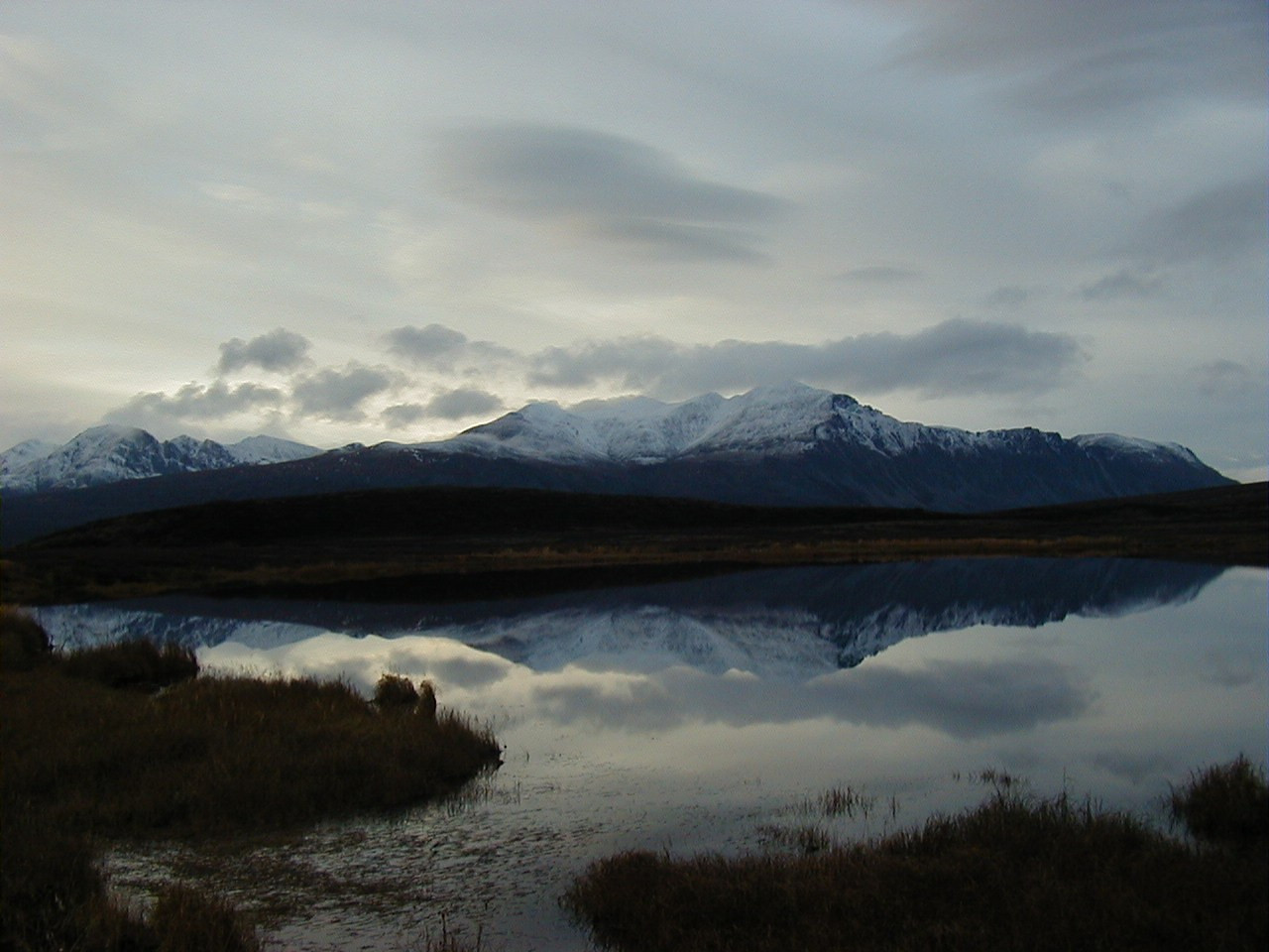 9/28/02 - Denali Hwy. near Tangle River.  Snow beginning to come down the mountains as fall heralds the coming of another winter.