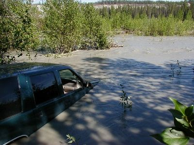 "Gee!  The river wasn't this deep last week when we drove out to the island.  The Tazlina River, south of Glennallen. (No, that's not my Suburban.  When I heard about this from the owner, I contacted a wrecker operator and then brought my camera to ""help"".)"