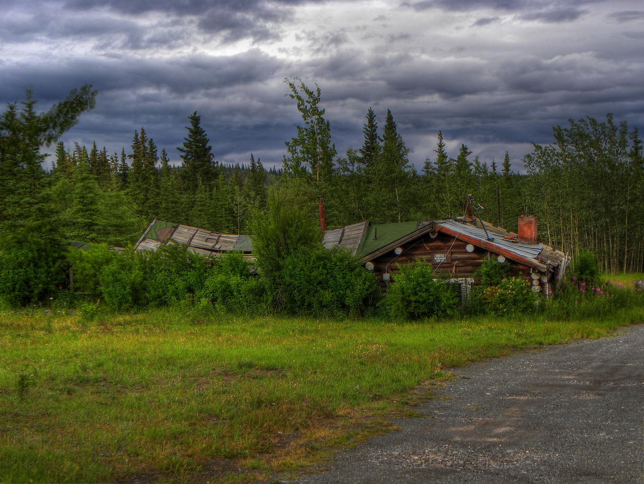 Copper Center, Alaska - This log cabin has been unoccupied for quite a few years, obviously.  Next to it are more cabins, an old barn, and various outbuildings.  In the area are several cabins, now in similar state of disrepair, that have actually served as habitations until recent years.