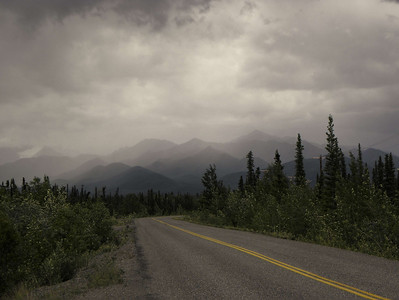 About a mile and a half northwest of my home, this view of the mountains conveys the stormy weather that is about to be unleashed on our small community.  Being on a motorcycle at the time, I was glad to make it in the door before the downpour let loose.