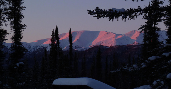 February 5, 2011  4:42 PM:  Sunset paints the peaks of the Mentasta Mts with alpenglow, one of my favorite scenes viewed through the kitchen window.