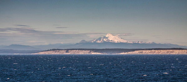 Mount Rainier appears from ship near Seattle, Washington