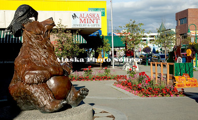 Alaska. Bear and Raven Statue on 4th Avenue, downtown Anchorage.