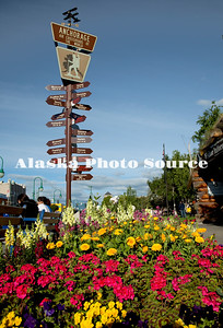 Alaska. Anchorage Crossraods Sign next to the Log Cabin Visitor and Information Center downtown.