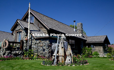 Alaska. Historical Moose Horn Club/Tomrdle House, Kenai.  This hand-hewed log structure was built in 1902. It once housed the first social club in Kenai as well as a candy store, theatre and church.