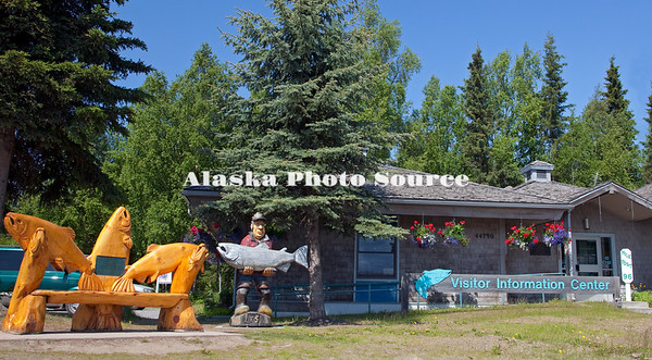 Alaska. Soldotna Visitor Information Center, along the Sterling Highway, displaying large salmon and fisherman wood carvings.