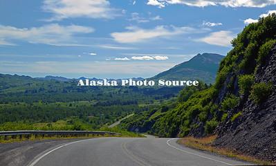 Alaska. A summer scenic view along Chiniak Road descending around Heitman Mountains Kodiak.