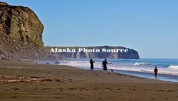 Alaska, Summer view of a family enjoying a summer day at a Narrow Cape Beach, along Pasagshak Bay Road, Kodiak.