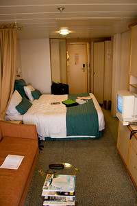 Our small yet practical room.  The bed and sheets were really comfortable.  The couch: not so much.  The TV didn't get many channels, but they made sure we had an entire network dedicated to things we could buy on the ship
