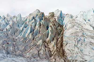I'm not exactly sure what the dark color is.  But the overall blue color of the glaciers was really cool.