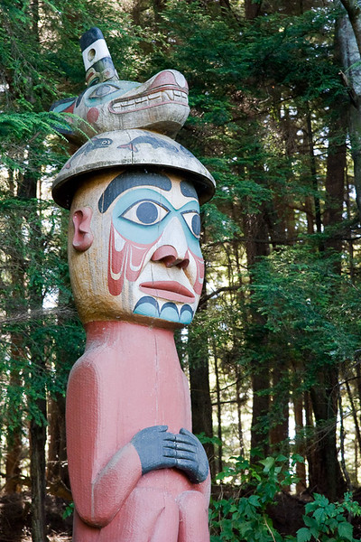 "The ""Man wearing Bear Hat"" pole is a Tlingit grave marker."