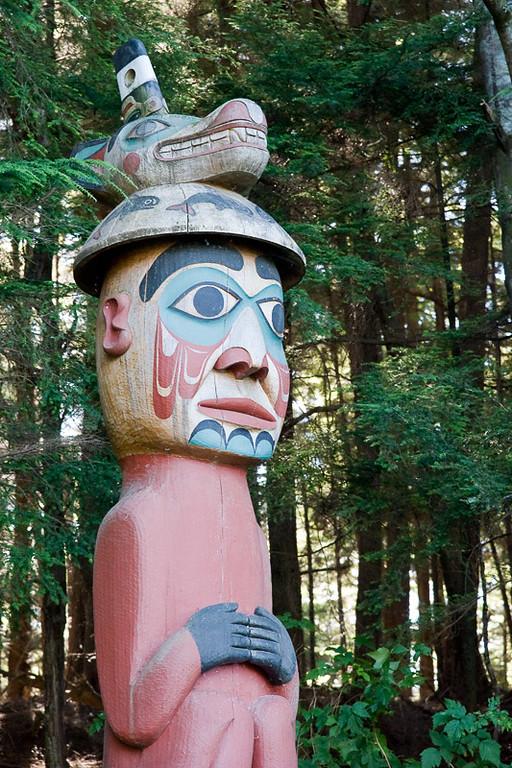 "The ""Man wearing Bear Hat"" pole is a Tlingit grave marker."