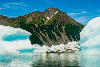 Paddling through the icebergs on Bear Lake, Kenai Fjords National Park, Alaska
