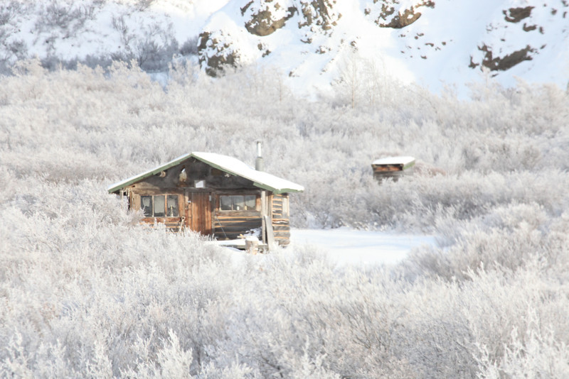 A cabin in an frozen field in the British Columbia Canada.