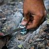 Hand tightening the bolt.
