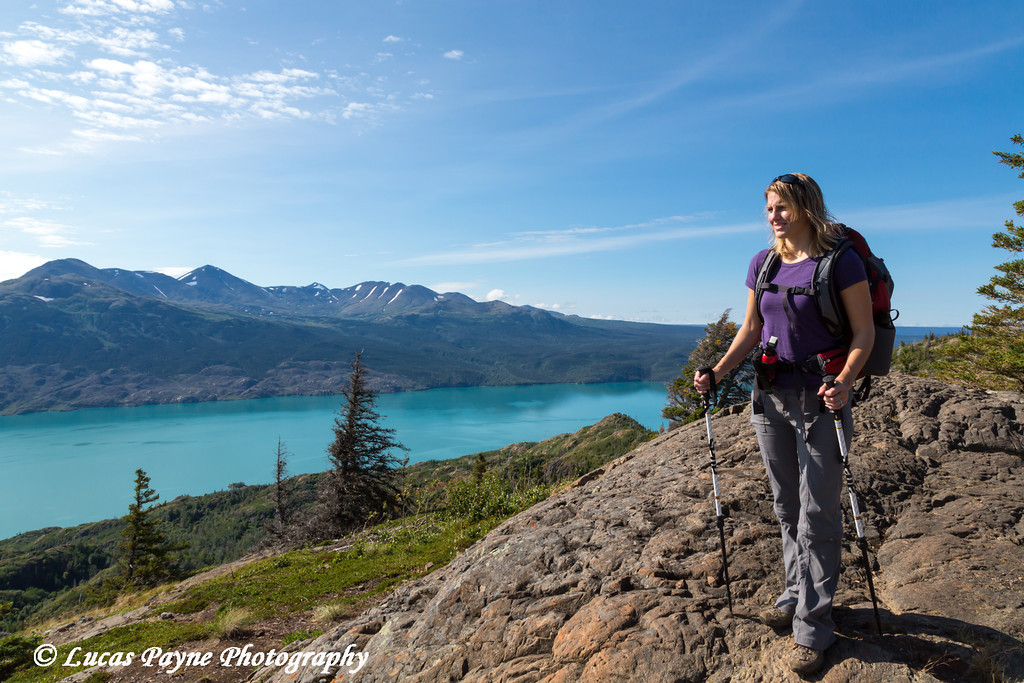 Female hiker enjoying the view of Skilak Lake from the Skilak Lookout Trail in the Kenai National Wildlife Refuge, Kenai Peninsula, Southcentral Alaska<br /> <br /> August 11, 2012