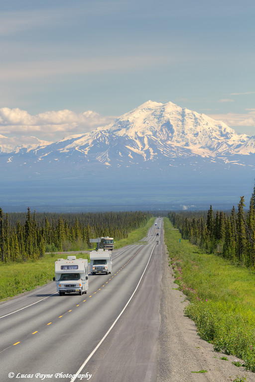 Motorhomes travelling on the scenic Glenn Highway near Glennallen with Mt. Drum and the Wrangell Mountains in the background, Southcentral Alaska.<br /> <br /> July 05, 2014