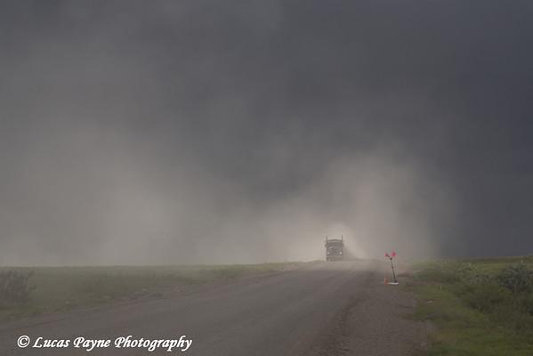 Semi truck driving on the dusty Haul Road (James Dalton Highway), Arctic Alaska.<br /> <br /> July 04, 2013