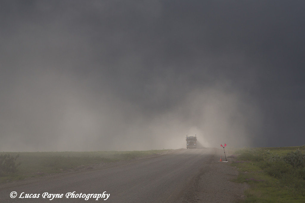 Semi truck driving on the dusty Haul Road (James Dalton Highway), Arctic Alaska.<br /> <br /> July 04, 2013