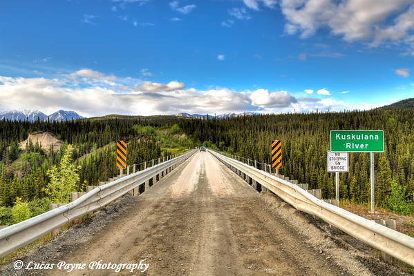Truck driving across the Kuskulana River Bridge on the McCarthy Road in Wrangell-St. Elias National Park and Preserve<br /> <br /> June 15, 2012