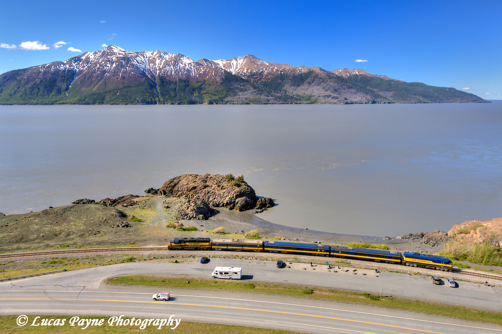 An Alaska Railroad passenger train passing by Beluga Point along the Seward Highway and Turnagain Arm south of Anchorage, Alaska.<br /> <br /> June 06, 2013