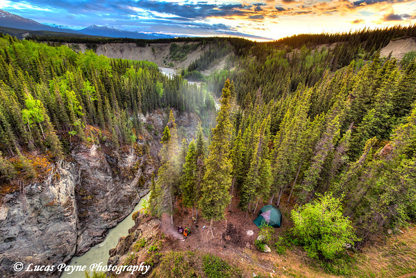 Scenic view of a campsite along the Kuskulana River Canyon at sunset from the Kuskulana River Bridge on the McCarthy Road in Wrangell-St. Elias National Park and Preserve<br /> <br /> June 15, 2012