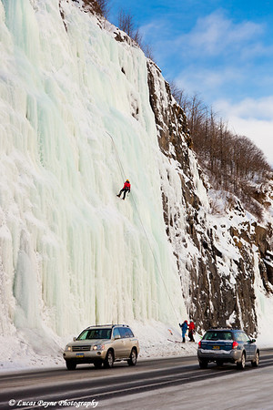 Ice Climbers on a frozen waterfall with traffic passing by on the Seward Highway<br /> January 28, 2012