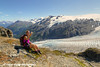 Female hiker using a smart phone to take a self-portrait with Exit Glacier and the Harding Icefield in the background, Kenai Fjords National Park, Kenai Peninsula, Southcentral Alaska. <br /> <br /> August 02, 2014