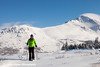Woman snowshoeing at the Glen Alps area of Chugach State Park on a sunny winter day, Anchorage, Alaska<br /> <br /> February 18, 2013