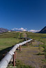 View of the Trans Alaska Oil Pipeline and Pump Station 4 north of Atigun Pass in the Brooks Range, Arctic Alaska.<br /> <br /> July 03, 2013