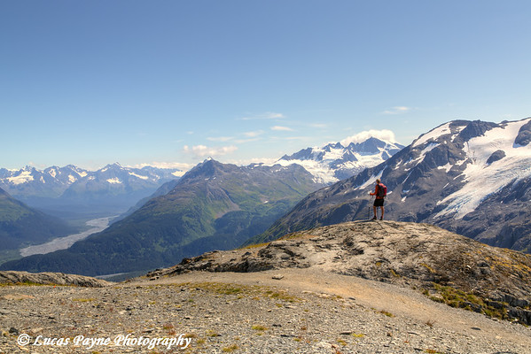 Female backpacker enjoying the view of the Resurrection River Valley from the Harding Icefield Trail near Seward, Kenai Fjords National Park, Kenai Peninsula, Southcentral Alaska. <br /> <br /> August 02, 2014