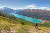Hiker on the Twin Peaks Trail overlooking Eklutna Lake in Chugach State Park, Southcentral Alaska.<br /> <br /> June 03, 2014