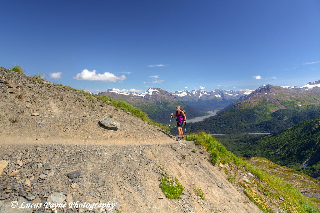 Woman hiking the Harding Icefield Trail in Kenai Fjords National Park near Seward, Kenai Peninsula, Southcentral Alaska.<br /> <br /> August 02, 2014