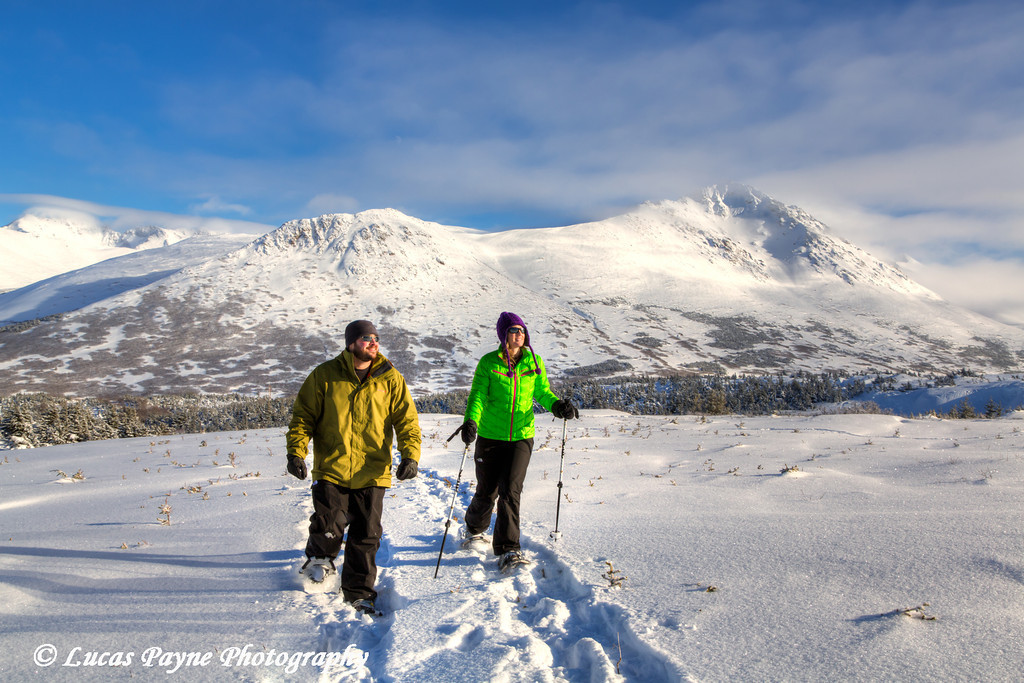 Couple snowshoeing at the Glen Alps area of Chugach State Park on a sunny winter day, Anchorage, Alaska<br /> <br /> February 18, 2013