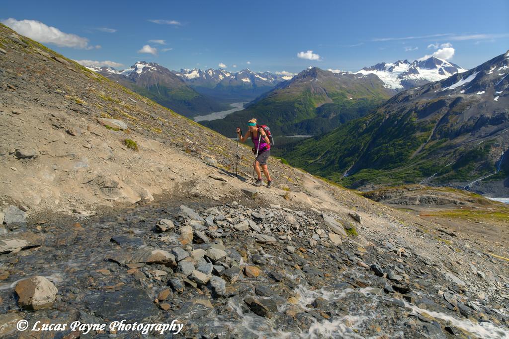 Woman hiking the Harding Icefield Trail in Kenai Fjords National Park near Seward, Kenai Peninsula, Southcentral Alaska. <br /> <br /> August 02, 2014