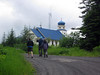 We walk uphill to Chenega Bay--biggest structure is its blue-domed church