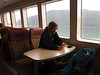 On the fast ferry back to Juneau, Nathan prepares the video of their unicycle event--that started in snowy dark