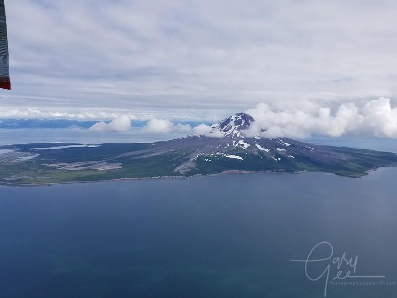 Augustine Volcano viewed on the way to Brooks Falls in Katmai National Park, Alaska. - phone shot