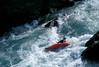 Kayaker on Six Mile River on the Kenai Peninsula.