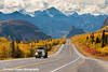 Dump Truck travelling on the Glenn Highway with Lion's Head Mountain and the Chugach Mountains in the background<br /> September 08, 2011