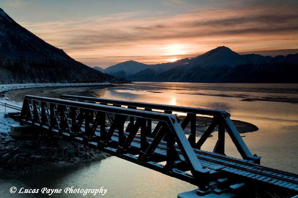Sunrise and an Alaska Railroad Bridge over Bird Creek along Turnagain Arm.<br /> November 13, 2008