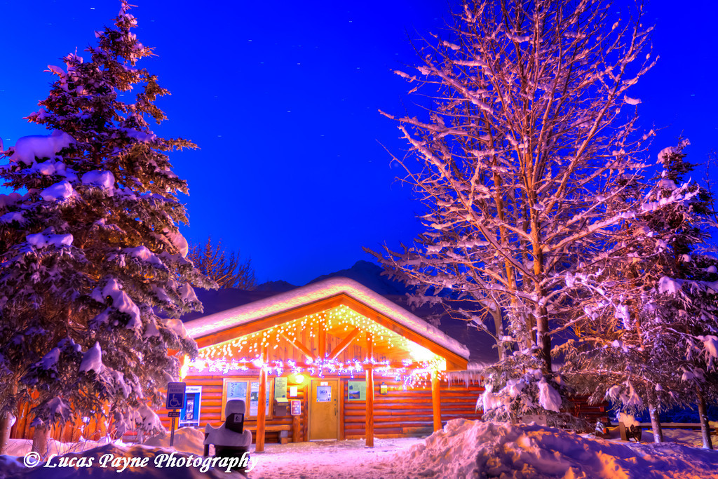Christmas Lights decorate the Eagle River Nature Center on a clear winter morning in the Chugach Mountains<br /> HDR<br /> November 26, 2011
