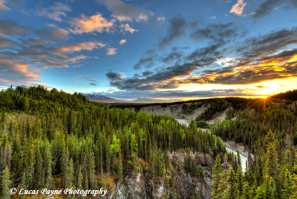 Scenic view of the Kuskulana River Canyon at sunset from the Kuskulana River Bridge on the McCarthy Road in Wrangell-St. Elias National Park and Preserve<br /> <br /> June 15, 2012