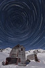 Star trails circle above Independence Mine and the Talkeetna Mountains at Hatcher Pass State Recreation Area, Matanuska Valley, Alaska.<br /> <br /> April 10, 2014