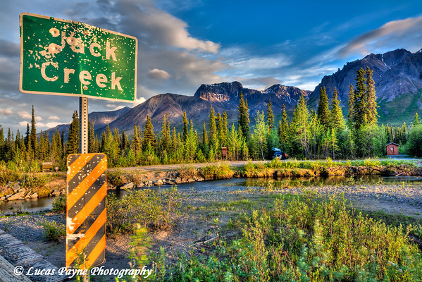 Jack Creek Sign on the Nabesna Road with Skookum Volcano at sunset in Wrangell St. Elias National Park and Preserve<br /> June 10, 2011<br /> HDR