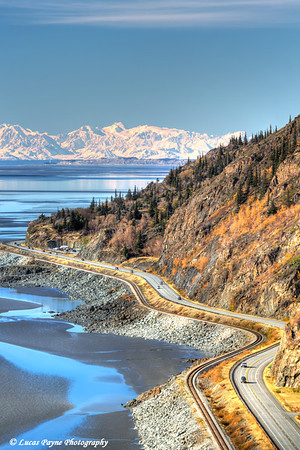 View overlooking traffic on the Seward Highway along Turnagain Arm with the snowcovered Alaska Range in the background<br /> HDR<br /> <br /> September 30, 2012