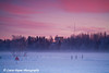 Ice skaters at sunset on Westchester Lagoon in Anchorage, Alaska<br /> January 30, 2010