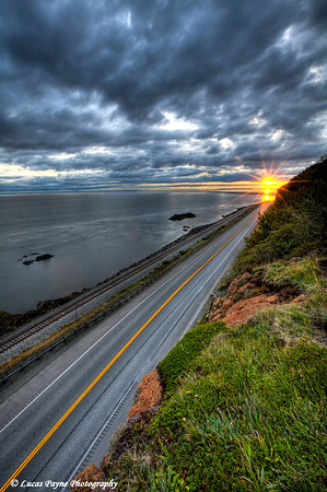 Sunset over Turnagain Arm and the Seward Highway from McHugh Creek.<br /> August 5, 2010